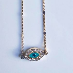 URBAN OUTFITTERS: GOLD-BLUE EYE NECKLACE